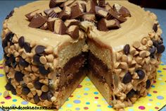 Hugs & CookiesXOXO: REESE'S OVERLOAD CAKE-2 PEANUT BUTTER BLONDIE LAYERS, 1 CHOCOLATE CHEESECAKE LAYER FILLED WITH AN INTENSE CHOCOLATE FROS...