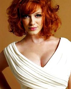 Christina Hendricks. she's such a beautiful redhead! i'm thinking about cutting my hair like this!!!