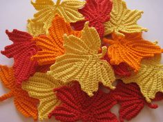 I just found the most wonderful shop on Etsy for crocheted trims!  Crocheted Maple Leaves in Red Orange and by GoldenLucyCrafts, $7.50