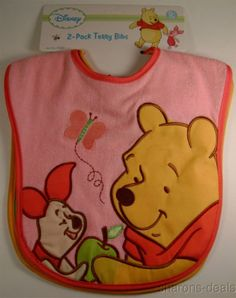 "Disney 2-Pack Terry Bibs For Girls 1 Pink Bib - Winnie the Pooh & Piglet 1 Green Bib - Winnie the Pooh & Tigger Too! 0+ Months Bibs measure 10"" long (shoulders to bottom) & 11"" wide (at shoulders) Bib"