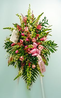 Standing Easel spray make with snapdragons, roses, tulips, and lilies.