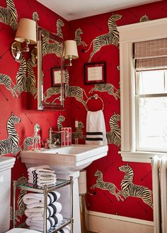 Design ideas for small bathrooms. This guest bathroom features a pedestal sink and Scalamandre red zebra wallpaper. Interior design by Liz Caan. Inspiration found in The New York Times. Zebra Wallpaper, Colorful Wallpaper, Red Interior Design, Dyi, Wallpaper Companies, Bathroom Red, Bathroom Wallpaper Red, Washroom, Bathroom Ideas