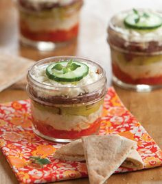 Individual 5-Layer Greek Dip - roasted red peppers, hummus, pepperoncini peppers, kalamata olives, feta cheese ... cute way to serve!