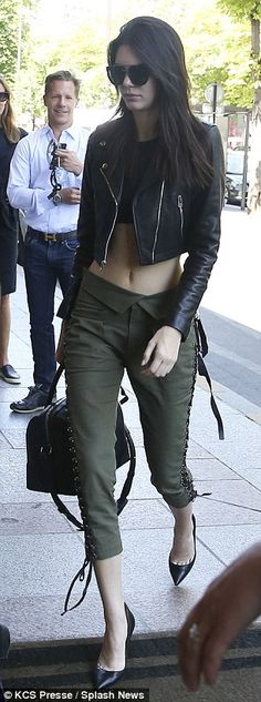 Kendall Jenner shows off model frame in crop top and khaki trousers #dailymail