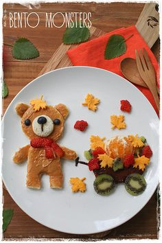 Nut butter Bear sandwich with carrot, strawberry and kiwi leaves. SO CUTE!