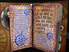 Octopus's Garden altered books and journals by Ingrid Djiker, I believe.  I like the coppery pen and (being a scientist), the round, cell-looking things.