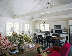 Love the farm table dividing the space. House Beautiful.