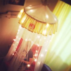 Monogrammed reading canopy... IKEA canopy, outdoor umbrella lights, sew a topper and chain cover, monogram