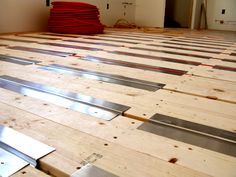 radiant heat prep glued down a high density foam board on the subfloor. The next layer is reflective foil. These two layers serve as an insulating barrier between our subfloor and this: