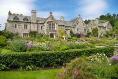 Cotehele    Few houses evoke the Middle Ages as readily as this sturdy manor of granite and slate, beautifully preserved with its original furnishings and so authentic to the period that electricity has never been installed. Exotic plants bloom in the terraced gardens.