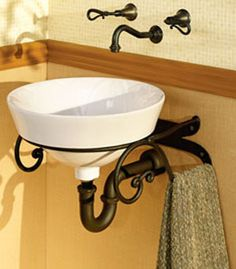 Wrought Iron Wall Mount Bracket.  Tiny powder room option.