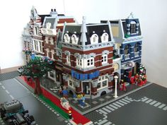 My street of modular buildings so far. I am still working on the street plates, but the idea with the bicycle path, grass and trees is there. It is inspired by the Lego Muntstraat of Jasper Joppe Geers.