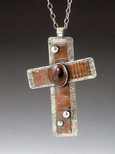 Hey, I found this really awesome Etsy listing at https://www.etsy.com/listing/207900320/large-cross-necklace-mixed-metal-tiger