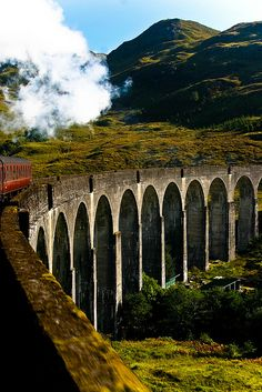 "The 21 arched Glenfinnan Viaduct in Scotland used for the ""Harry Potter"" films. We rode this steam train to Fort William on the west coast of Scotland. Oh The Places You'll Go, Places To Travel, Travel Destinations, Places To Visit, Wonderful Places, Beautiful Places, England And Scotland, Scotland Uk, Glencoe Scotland"