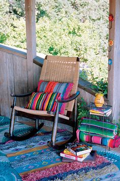 Pillows and rocking rattan chair. [ MexicanConnexionForTile.com ] #design #Talavera #handmade