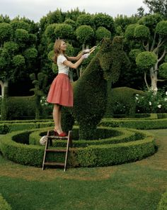 """""""a gardner's work is never done"""" -  (just like me, she gardens in high heels & a skirt!)"""