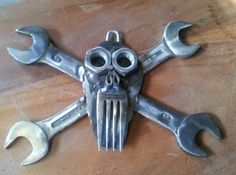 Wood scroll work skull backed by 'real' spanners?