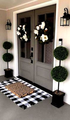 modern front porch with floral wreaths