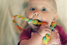 DIY Teething Necklace:  use material to cover wooden beads. Babies love these!