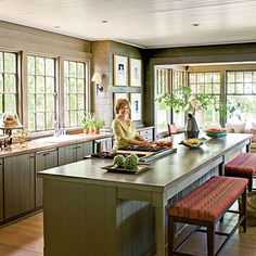 No upper cabinets. I like the idea of using a closed-off pantry room for storing all dishes, foods,etc. It's a pristine kitchen look.