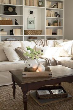 Rustic-and-Woven---Simple-Coffee-Table-Styling. Like the twist of hanging a picture inside the bookcase. Living Room Accessories, European Home Decor, Layout, Home Decor Styles, Home Interior Design, Home And Living, Pottery Barn, Living Room Decor, Family Room
