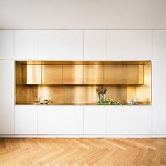 Serious brass kitchen and flooring goals by the German design geniuses at Zeitraum.