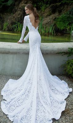 Long and flowing train. Lace wedding dress, long sleeve, low cut back