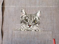 hand embroidered cat in the pocket on the light brown linen chambray shirt for women