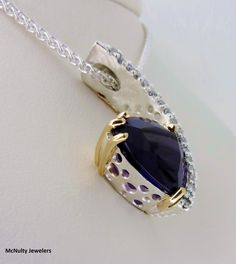 Our Master Jeweler created this gorgeous pendant for someone very near and dear to his heart! The sterling silver and diamond pendant features a trillion cut, deep purple amethyst set in 18kt yellow gold. A work of art and beautiful from every angle! McNulty Jewelers original design