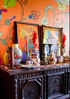 Love all of the colors mixed with orange. Those hand-painted walls are amazing!
