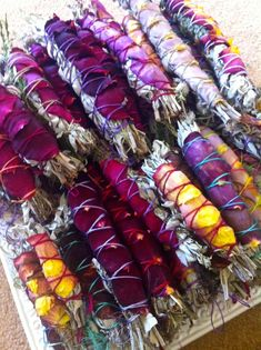 Sacred white sage is the preferred cleansing element of choice among native and tribal populations. Here, paired with a rainbow of rose petals. Custom orders are welcomed! www.sagegoddess.com high vibe smudge sticks!