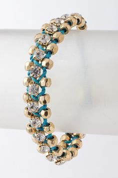 A mix of crystals hand wrapped in color and accented with Hammered Pebbles & a button closure.  $48