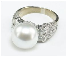 A PEARL, DIAMOND, AND 18 KARAT WHITE GOLD RING. Lot 150-7141 #jewelry