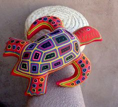 Red Mola Sea Turtle Pillow, by molamama on Etsy. For more than 20 years Dream Spirit Studio of New Mexico has created an economic avenue for indigenous women -- very gifted Kuna Indian artists who translate the artist's designs into completely hand sewn applique mola.