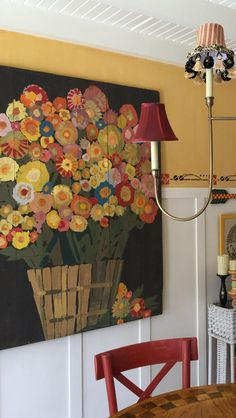 It's Mary Engelbreit's newly decorated dining room, but it's her find of a painting that she's jazzed up which I crave.