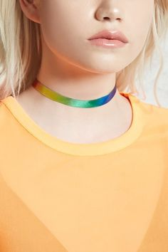 A woven ribbon choker featuring a rainbow color and a lobster clasp closure.