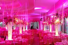 Our final layer was illuminating the centerpieces from below with LED fixtures, these fixtures really made the vases glow with a Rich pink color. Description from weddinglighting.wordpress.com. I searched for this on bing.com/images