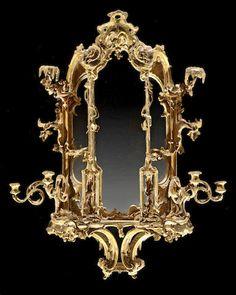 Italian Rococo, parcel giltwood, carta pesta and stucco girandole mirror second quarter 18th century