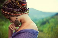 Beautiful hair and pretty earings. The mountain in the background tops it off.