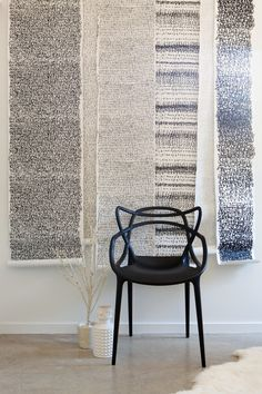 "scroll-like rolls of paper (of enlarged fonts) are thumbtacked to the wall elsewhere in the room too. ""We affixed them at the top and just let them be loose at the bottom,"" says Ford. ""They overlap and create an amazing texture."""