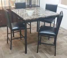 A great starter dining set...counter height and 4 chairs. $231.00