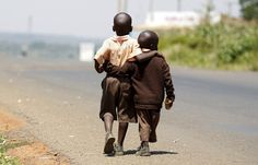 Two boys on their way home after school. Nairobi, Kenya