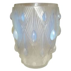 Sabino, France, around 1925 In form moulded opalescent glass vase. Signed inside, on the bottom of the vase, in relief. Very rare signature.
