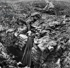 Verdun battle (Meuse, France) 1916: a soldier looking bodies of dead soldiers