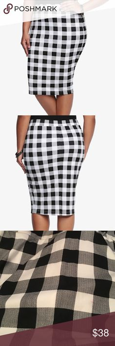"""Torrid black/white checkered print pencil skirt """"Form fitting. Check. Black and white plaid pattern. Check. Trend-on midi length. Check. This flattering contemporary skirt meets our hot list of approval and should definitely be on your check list of must-haves. Polyester/spandex."""" New with tags, size 0X. Small red dot on front of skirt (last picture). torrid Skirts Pencil"""