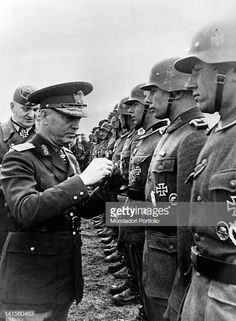 Romanian Marshal Ion Victor Antonescu conferring a decoration to a group of German soldiers after their victorious actions in Crimea. May 1942 Get premium, high resolution news photos at Getty Images Cross Of Iron, May 1, Troops, Soldiers, Politicians, World War Ii, Romania, Victorious, Wwii
