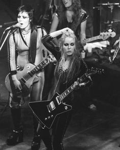 The Runaways on stage, with Joan Jett and Lita Ford in the foreground and Jackie Fox on bass Lita Ford, Lzzy Hale, Joan Jett, Daft Punk, Bass, Ozzy Osbourne, Close My Eyes, Black Sabbath, Hayley Williams