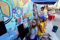 This community has an open day each year when everyone adds their bit to a mural.