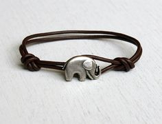 This elephant bracelet is made of a elephant charm and genuine leather cord. It's special, simple and cute. You can wear it every day. The elephant charm is made of metal in antique silver or gold finish and made in Italy. The size of button is 20.5mm x 13mm. The default color is antique silver. Please leave the message if you want gold color. This bracelet is not adjustable. The size is the inside perimeter of the bracelet. Please convo me if you like to have more.