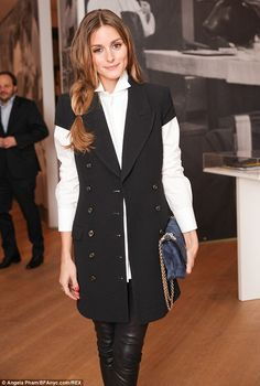 Pretty penguin: Olivia looked stylish in her black and white shirt and jacket combo, which was reminiscent of a penguin suit